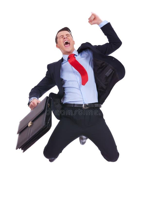 Super aufgeregter Geschäftsmann mit Aktenkoffer lizenzfreies stockbild