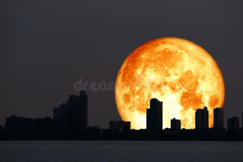 super blood Hay moon planet back silhouette city and night sky royalty free stock photos