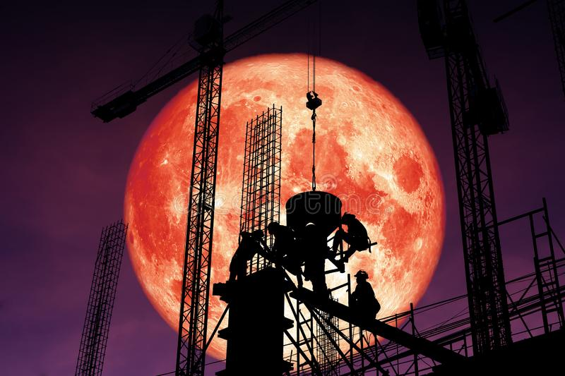 super blood moon back silhouette worker on construction night sk stock photography