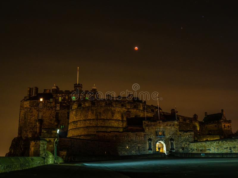 Super blood moon lunar eclipse, Edinburgh Castle at night. Wide-angle of Edinburgh Castle at night under super blood wolf moon lunar eclipse, 21 January 2019 royalty free stock images