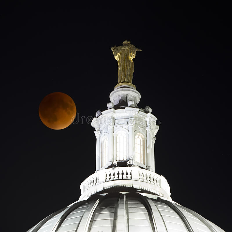 2015 Super Blood Moon over Madison, Wisconsin Capitol. 2015 Super Blood Moon during lunar eclipse over Wisconsin State Capitol building in Madison royalty free stock image