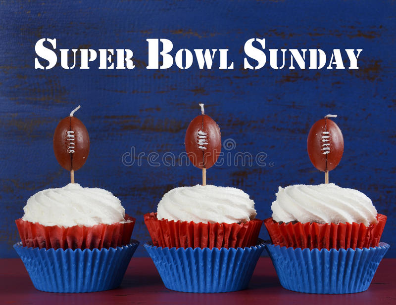 Super Bowl cupcakes with sample text. Red, white and blue theme cupcakes with football toppers for Super Bowl Sunday party or collage football finals and royalty free stock photos