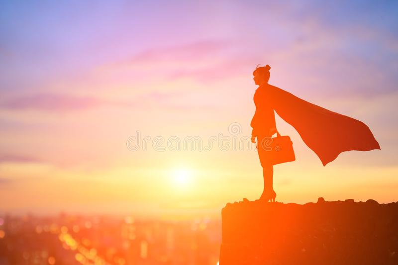 Super business woman on mountain royalty free stock photography