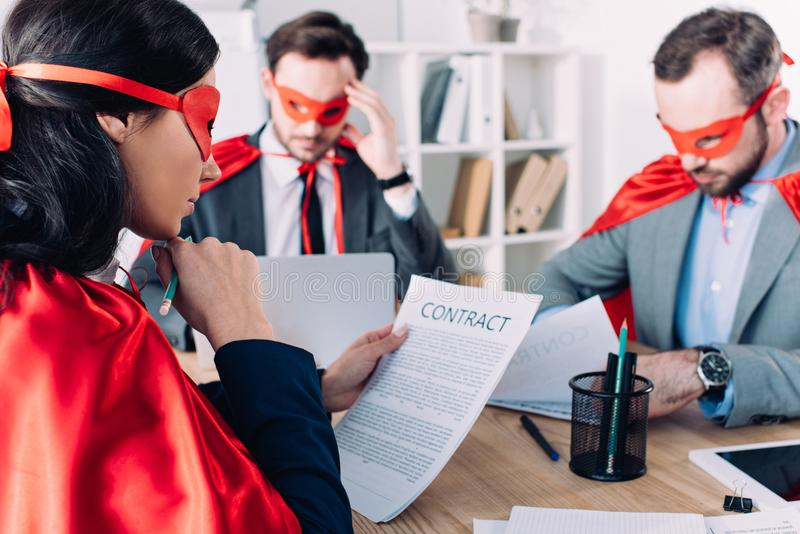 super businesspeople in masks and capes working royalty free stock image