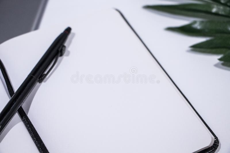 Super close up of a travel book and a pen stock photo