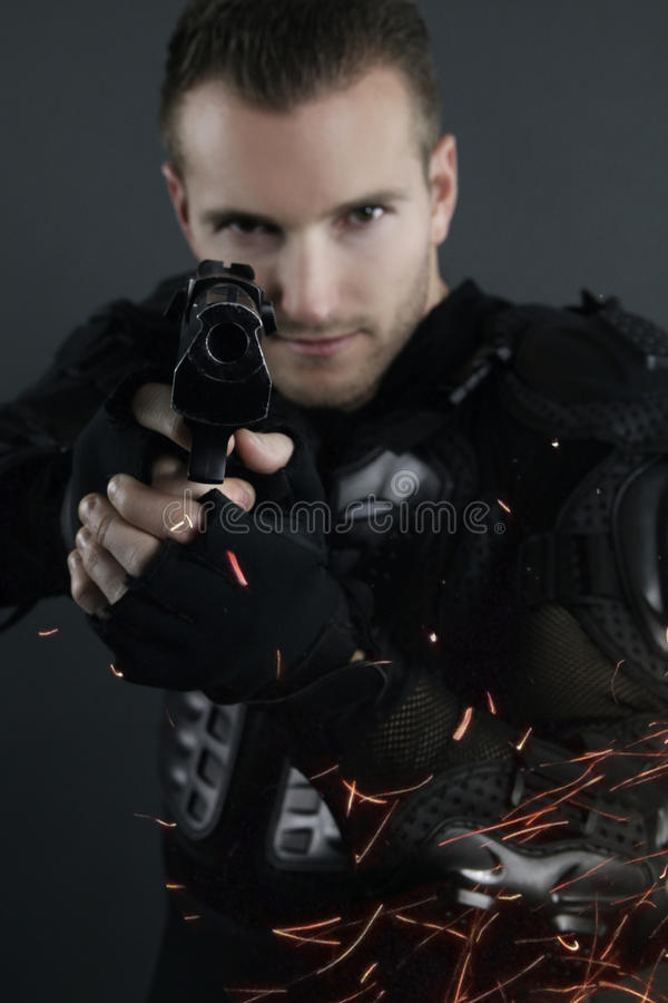 Super cops - blond man posing with a gun royalty free stock photography