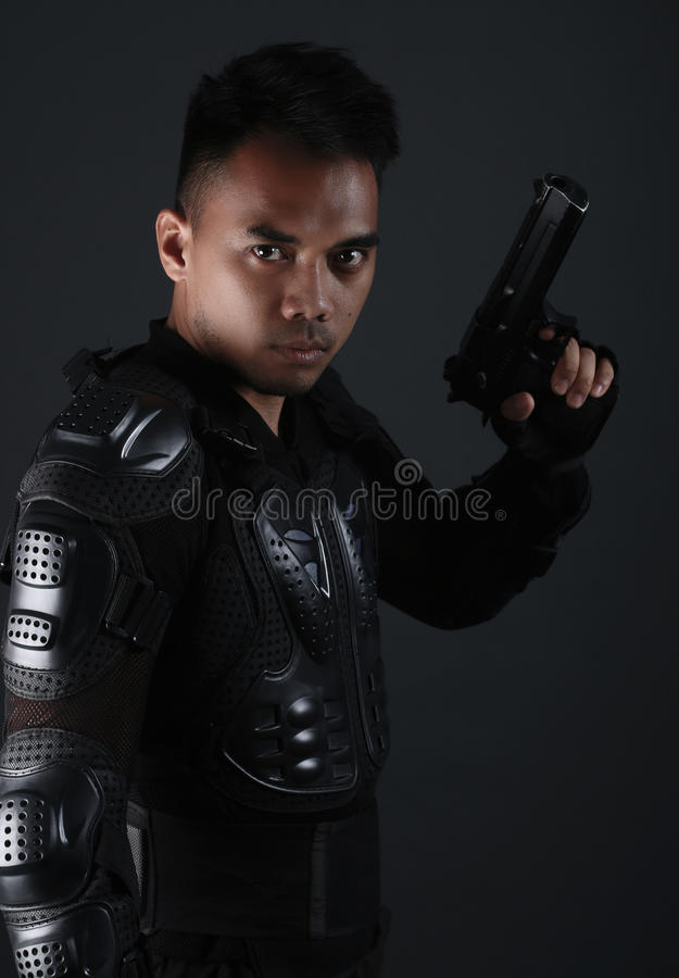 Super Cops- Handsome asian man holding a gun stock photography