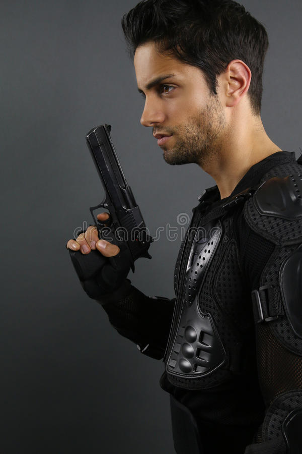 Super cops - handsome man posing with a gun stock photo