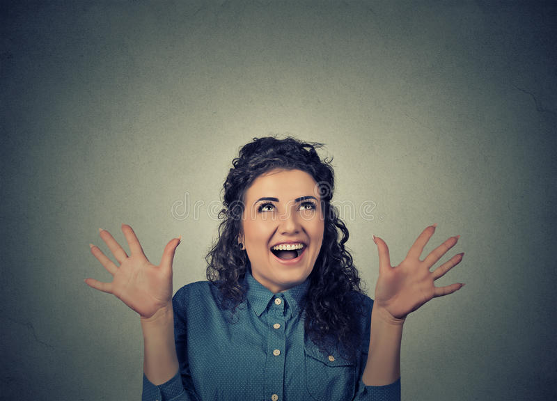 Super excited girl looking up thrilled screaming stock image