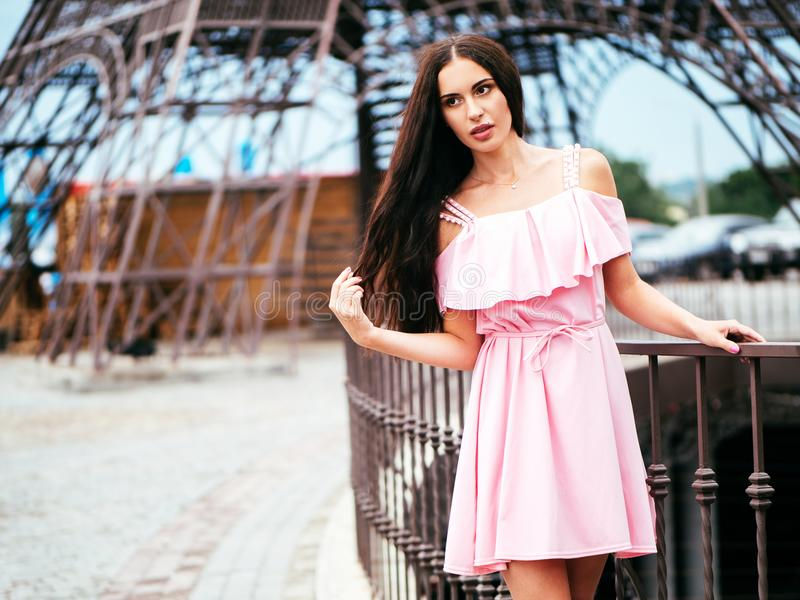 A super fashionable brunette with long hair stock images