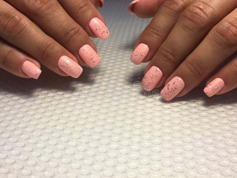 Super Fashionable coral manicure with silver design stock photo