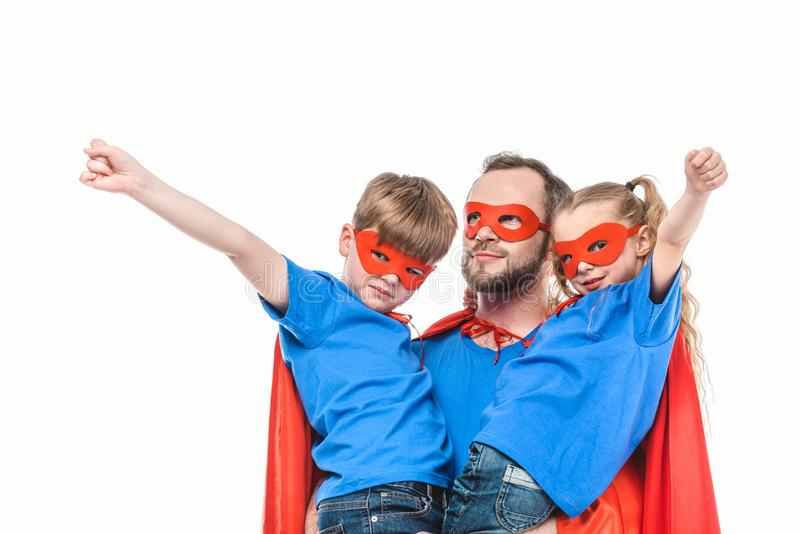 super father with children in masks and cloaks pretending to be superheroes royalty free stock images