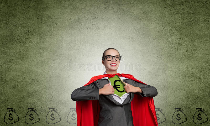 She is super financier. Young woman acting like super hero with euro sign on chest stock image