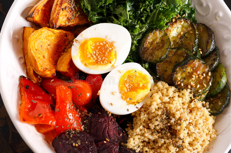 Super Food Bowl. With eggs, quinoa, and roasted vegetables royalty free stock photos