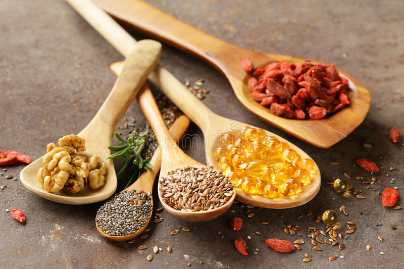 Super food - goji berries, chia seeds, flax seeds, walnuts and omega-3 royalty free stock photo