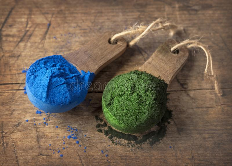 Super food powders. In wooden spoons royalty free stock photos