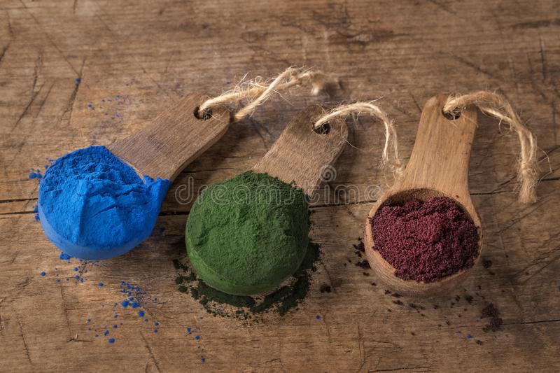 Super food powders. In wooden spoons stock image