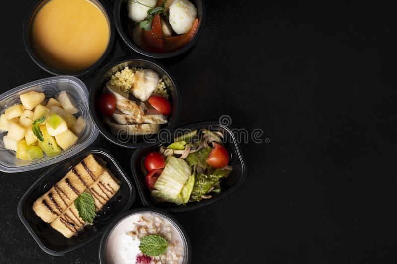 Super food and Vitamins, macronutrients and minerals in proper nutrition, balanced diet in eco food containers. Vegan cereals, super foods in eco containers and royalty free stock image