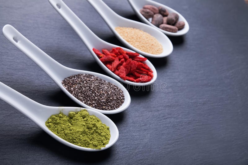 Super foods in spoons royalty free stock image