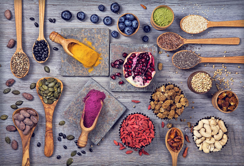 Super foods in spoons and bowls royalty free stock image