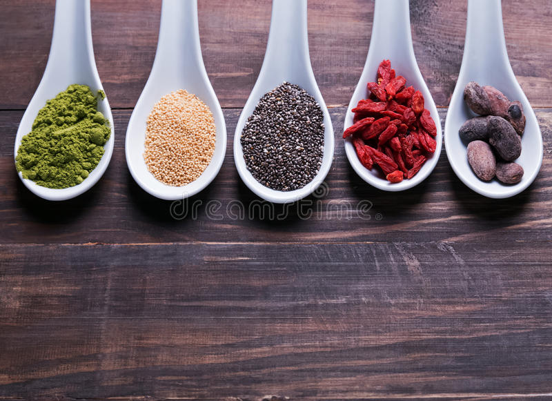 Super foods in spoons stock images
