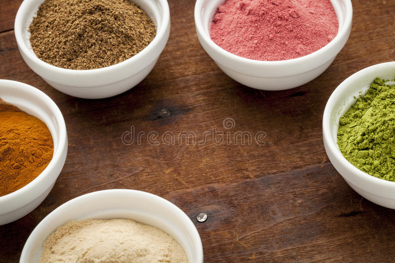 Super fruit and leaf powders stock photography