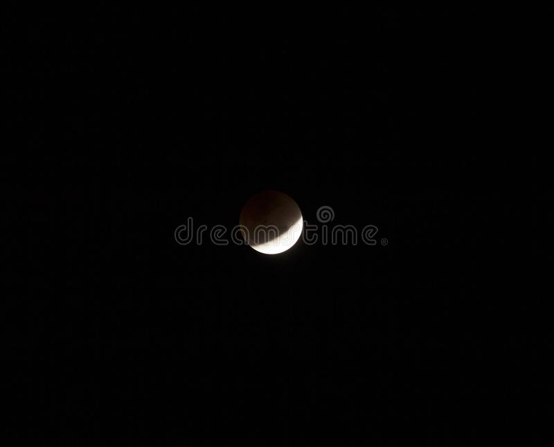 Super full blood moon. On dark sky royalty free stock photography