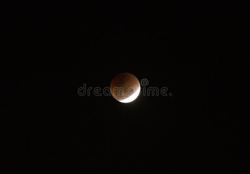 Super full blood moon. On dark sky stock image
