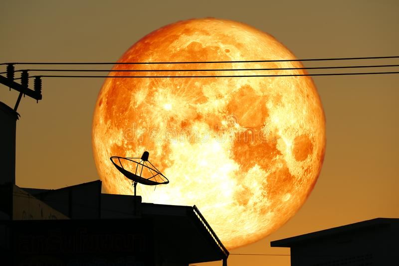 super full harvest blood moon on night sky back satellite dish on the roof royalty free stock photos