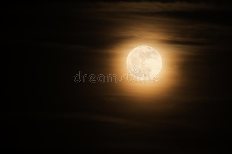 Super full moon known as a supermoon with soft clouds royalty free stock image