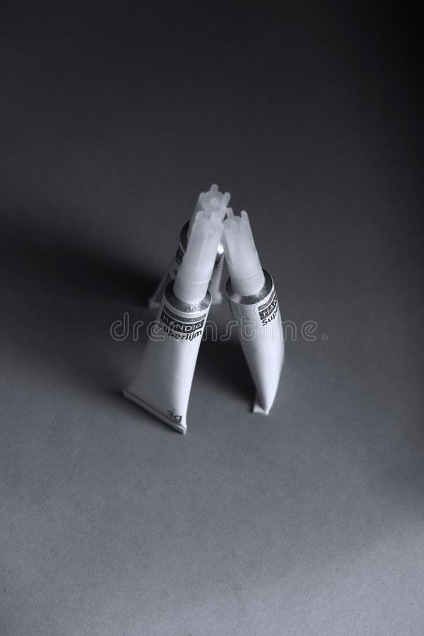 Super glue from Netherlands, Handig, isolated. Black background Copy space royalty free stock images