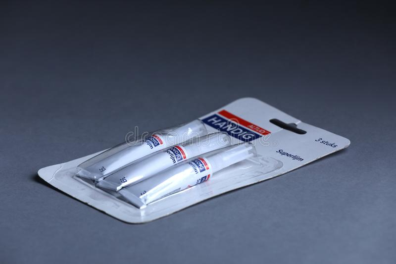 Super glue from Netherlands, Handig, isolated. Grey background Copy space stock images