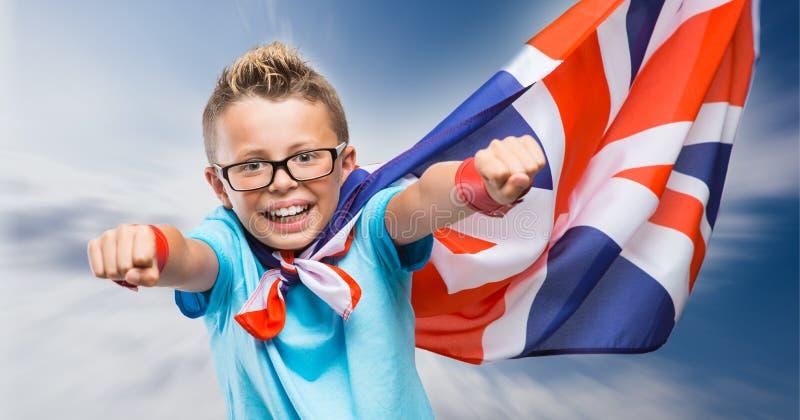 Super héroe británico sonriente imagen de archivo