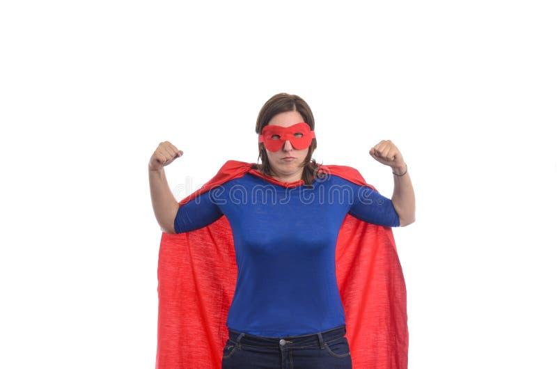 Super héroe de la mujer con el cabo rojo imagen de archivo