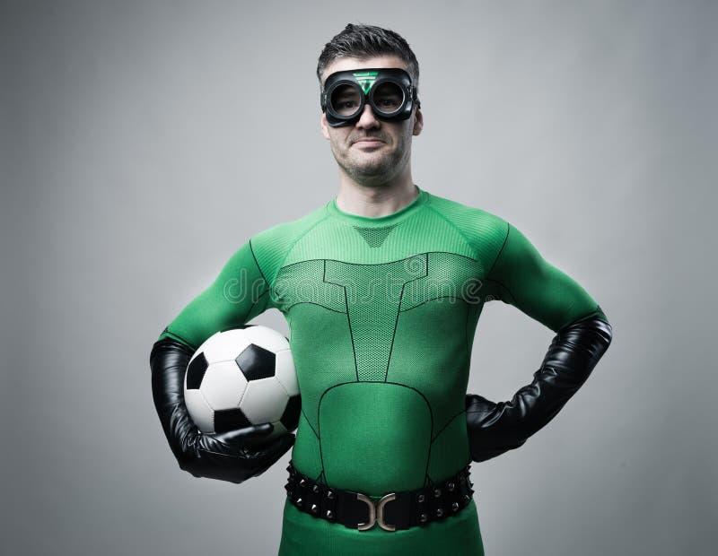Super-herói com bola de futebol fotografia de stock royalty free