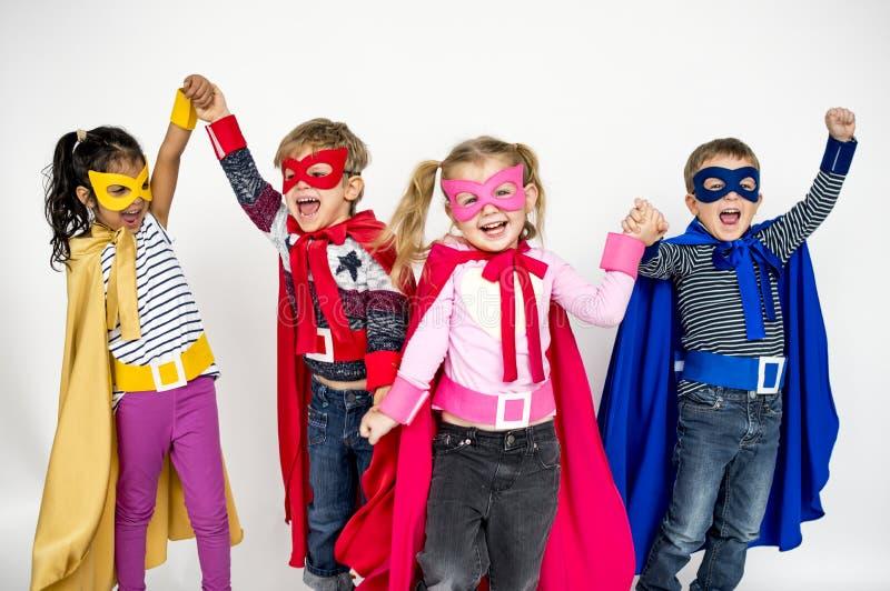 Super-herói das crianças que joga em torno do conceito fotografia de stock royalty free