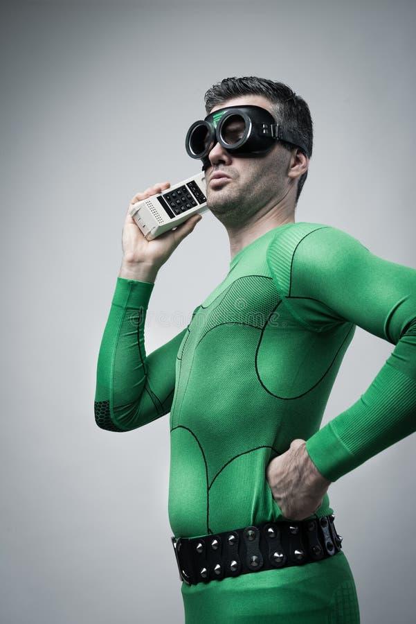 Super-herói no telefone imagem de stock