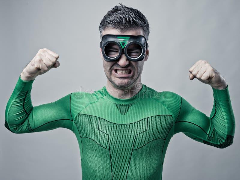 Super-herói que mostra o bíceps imagens de stock