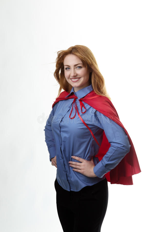 Super hero. Business woman wearing a super hero cape with wind in her hair stock photos