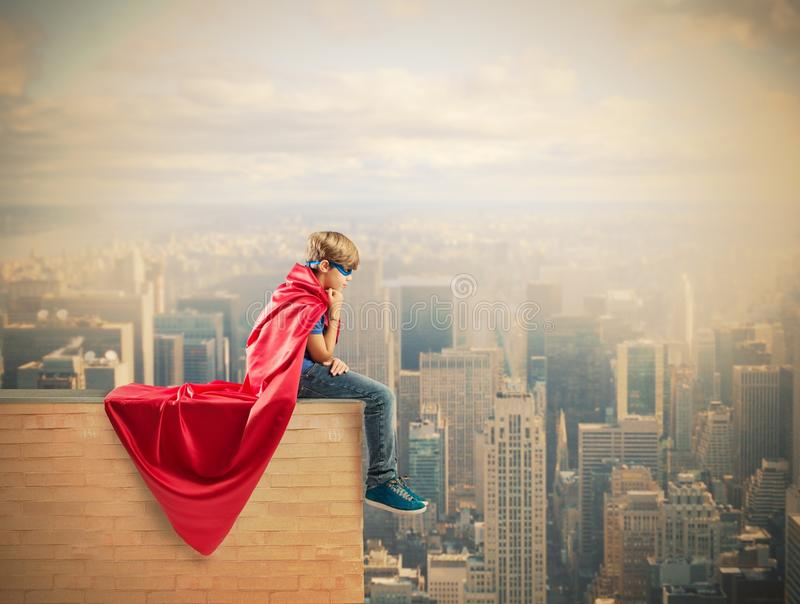 Super hero kid. Concept of fantasy of a super hero child royalty free stock photos