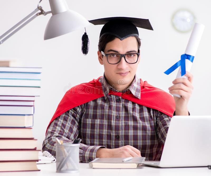 Super hero student wearing a mortarboard studying stock image