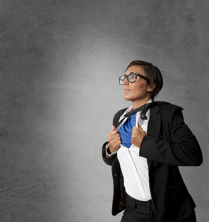Super hero woman in business. Concept of a super hero woman in business stock images