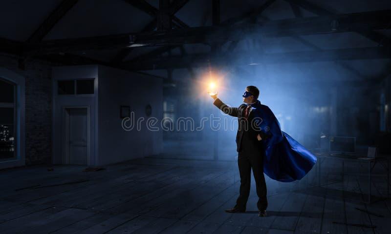 Super mężczyzna w niebie Mieszani środki fotografia stock