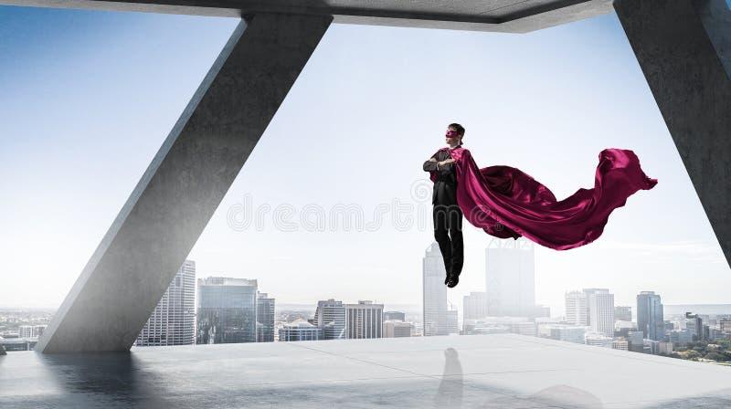 Super mężczyzna w niebie Mieszani środki obraz stock