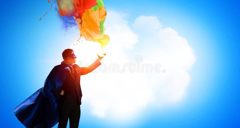 Super mężczyzna w niebie Mieszani środki obrazy royalty free