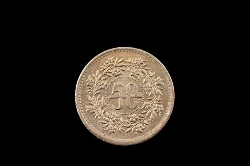 Old Pakistani Fifty Rupee Coin Isolated On Black royalty free stock image