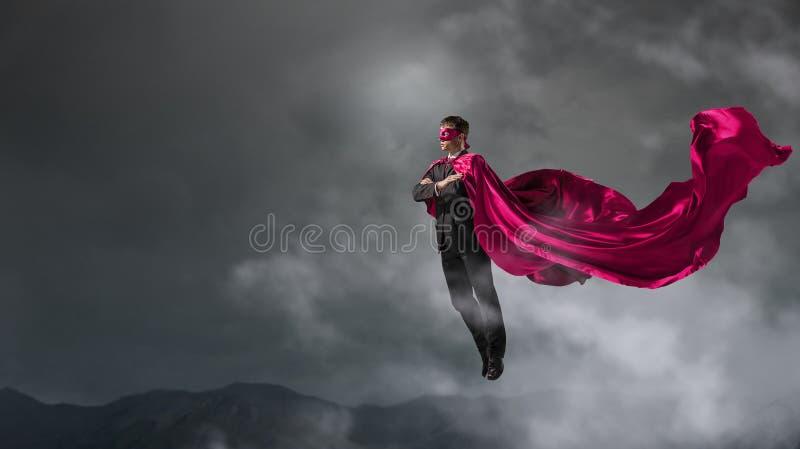 Super mens in hemel stock afbeeldingen