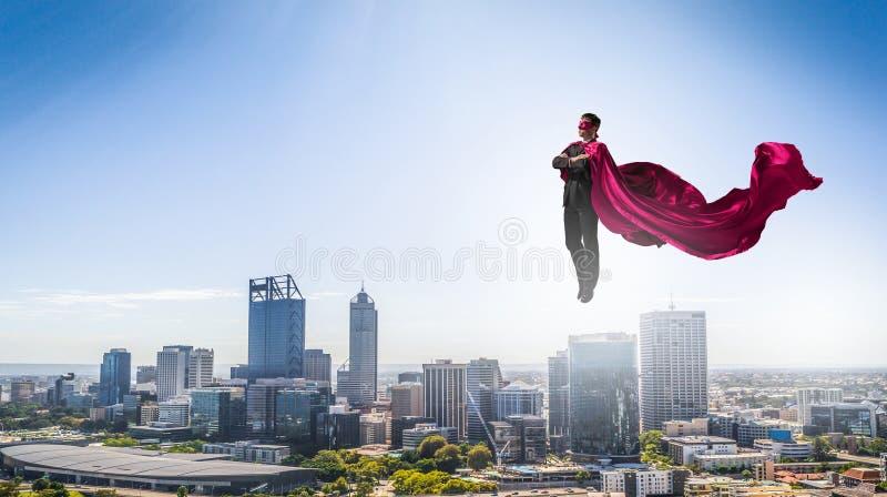Super mens in hemel stock afbeelding