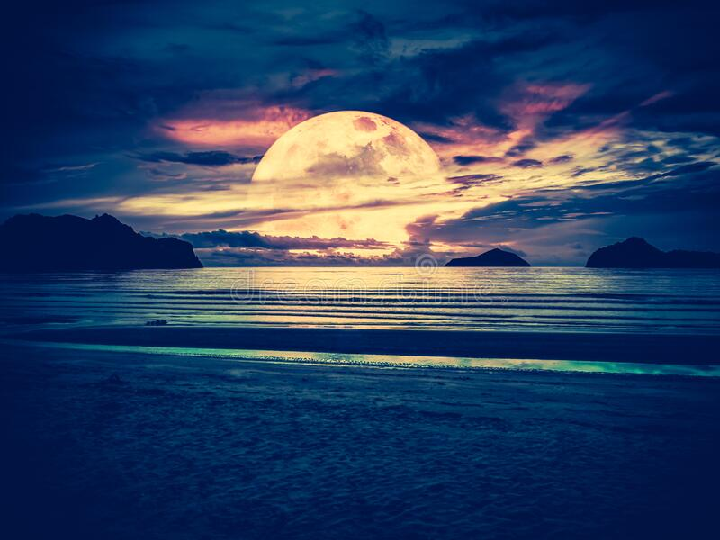 Super moon. Colorful sky with bright full moon over seascape. Serenity nature background, outdoor at gloaming. The moon taken with my own camera royalty free stock images