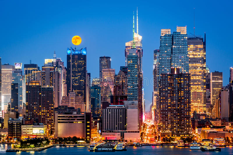 Super Moon in New York. Super Moon rise above the midtwon Manhattan skyline stock photo